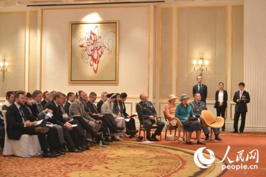 图为丹麦女王出席丹麦—中国创新与投资论坛现场